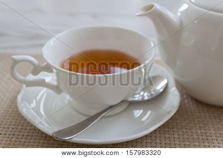 Afternoon tea with red tea set on wooden table background get ready for drinking.