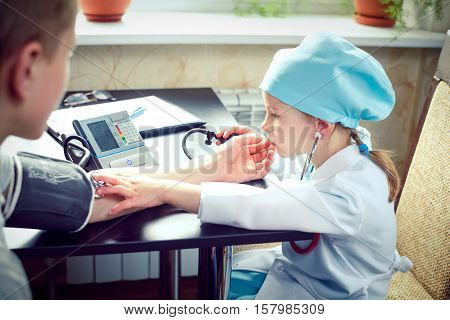 Children playing doctor and patient in the hospital