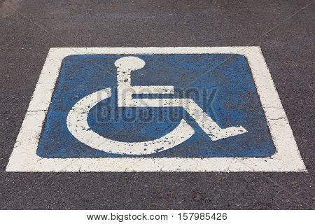 Disabled Parking sign at parking lot on street.
