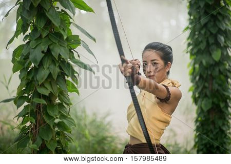 .beautiful Thai Woman Archer With Longbow And Arrows In Forest Background Vintage Style At Thailand