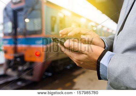 Businessman With Smartphone, Waiting At The Train Platform