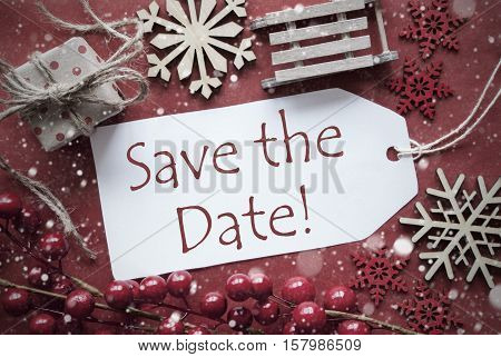 English Text Save The Date. Nostalgic Christmas Decoration Like Gift Or Present, Sleigh. Card For Seasons Greetings With Red Paper Background.