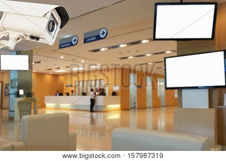 The CCTV security camera operating in medical record hospital blur background.