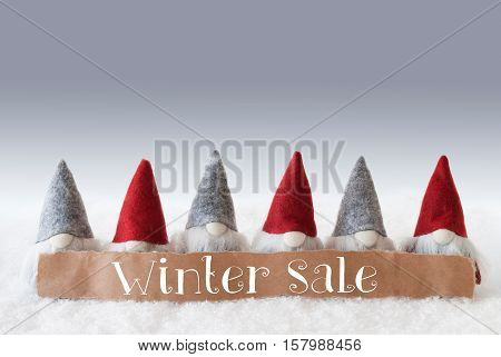Label With English Text Winter Sale. Christmas Greeting Card With Gnomes. Silver Background With Snow.