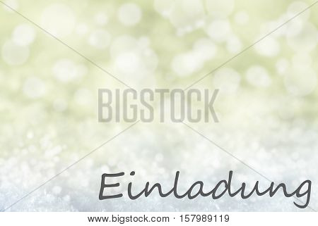 German Text Einladung Means Invitation. Golden Bokeh Christmas Background Or Texture With Snow. Copy Space For Your Text Here