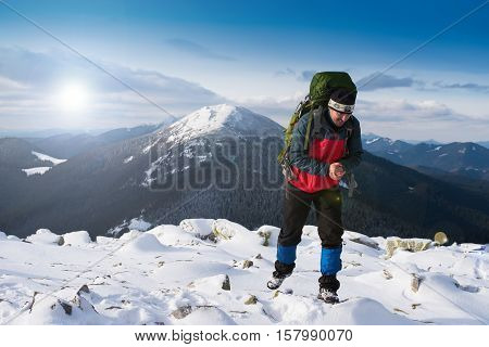 Man on peak of mountain. Emotional scene. Hiker. Happy hiker. Hiker mountain. Hike. Hiking. Concept success. Hiker sunset. Hiker smiling. Tired tourist. Tired hiker. Concept freedom.