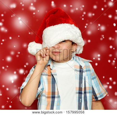 boy child portrait on red, winter holiday concept