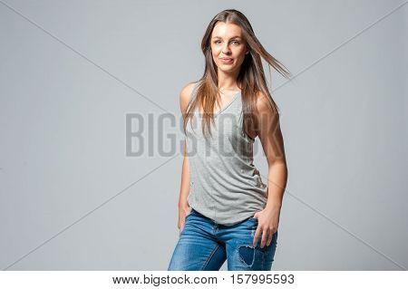 Brunette Femal On A Grey Background
