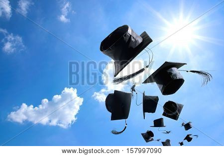 Graduation Ceremony, Graduation Caps, Hat Thrown In The Air With Bluesky Abstract Background.