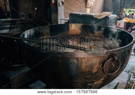 Amritsar, India - Cooks preparing food portion for pilgrims. The Kitchen at Golden Temple Feeds up to 100,000 People a Day for Free - Harmandir Sahib, Amritsar, India.