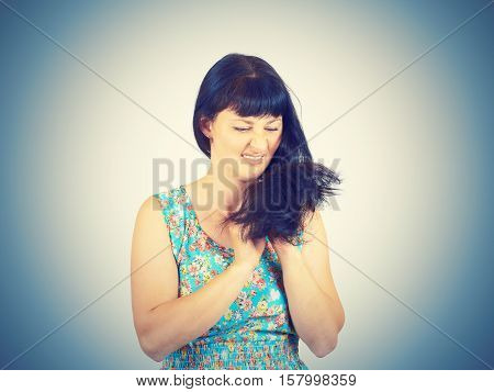 Young Woman Looks At Her Problematic Hairs.
