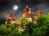Beautiful and old architecture of the famous Dracula castle in Bran town against the cloudy sky before the storm. Medieval building of Transylvania in Europe Romania poster