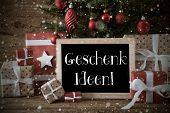 Chalkboard With German Text Geschenk Ideen Means Gift Ideas.. Nostalgic Card For Seasons Greetings. Christmas Tree With Balls And Snowflakes. Gifts In The Front Of Wooden Background. poster