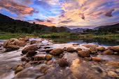 Landscape of small river and beautiful sunset in Kiriwong village. The best Ozone location in Thailand poster