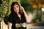 Beautiful plus size model outdoors. Shallow DOF. poster