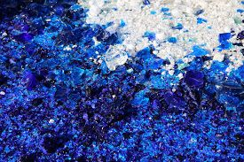 abstract background with blue and white glass particles