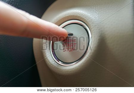 Hand Pushing A Push Start Button Of A Car / Automobile With Keyless Entry