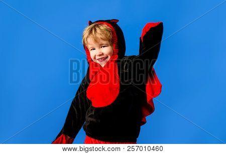 Little Boy In Black&red Dinosaur Costume. Cute Little Baby In Dinosaur Bodysuit. Funny Little Guy In