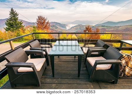 Terrace With Beautiful View In To The Mountains. Autumn Season With Red Foliage On Forested Hills. C