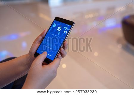 Chiang Mai, Thailand - August 03,2018: Woman Hands Holding Huawei With Facebook App On The Screen. F