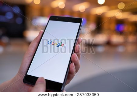 Chiang Mai, Thailand - August 03,2018: Woman Hands Holding Huawei With Google Search On Screen. Goog