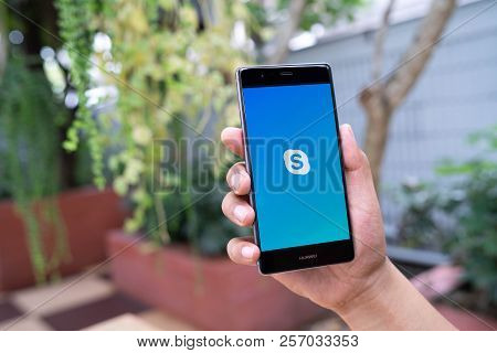 Chiang Mai, Thailand - August 05,2018: Man Holding Huawei With Skype Apps. Skype Is Part Of Microsof