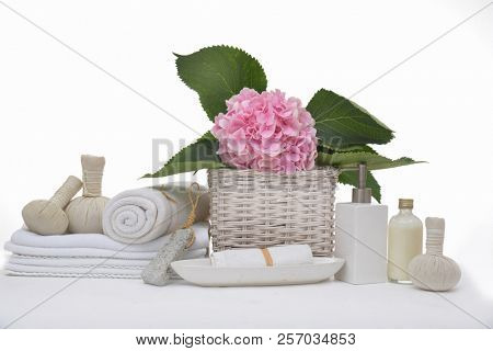 Spa background with hydrangea in basket with herbal ,candle,oil, towel, stones,