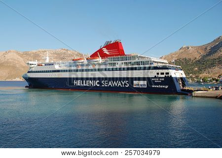 TILOS, GREECE - JUNE 18, 2018: Hellenic Seaways ferry boat Nissos Chios moored at Livadia harbour on the Greek island of Tilos. The 141mtr vessel was built in 2007 in Greece.