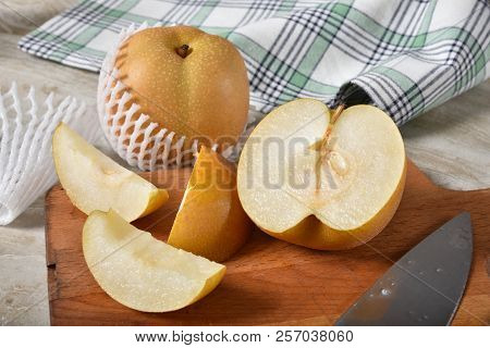 Sliced Asian Pears On A Cutting Board.  Also Known As Apple Pears, Asian Pear, Chinese Pear, Korean
