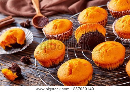 Close-up Of Pumpkin Muffins For Potluck Or Halloween Party. Ingredients On A Wooden Table, View From