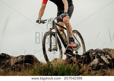 Dirty Athlete Cyclist On Mountain Bike Biking On Mountain Stone Trail