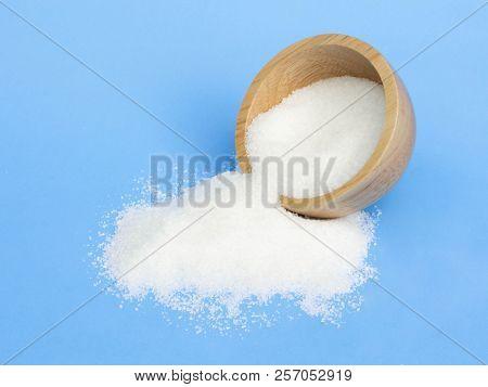 Monosodium Glutamate In Wood Bowl On Light Blue Background