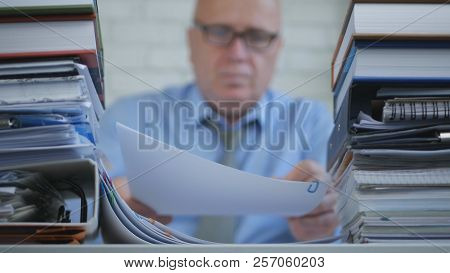 Blurred Image Businessperson In Accounting Archive Working With Documents