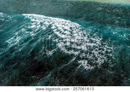 Top aerial shot of textured tropical sea waves
