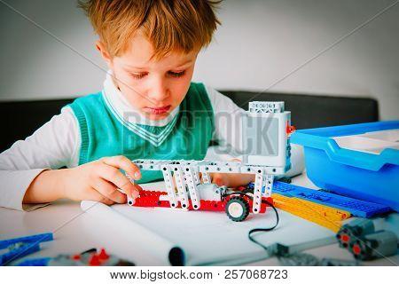 Little Boy Building Robot At Robotic Technology Lesson