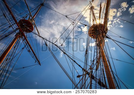 The Sun Poking Throught The Mast And Rigging Of A Sailing Ship In Virginia.