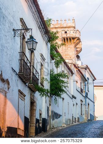 Street In The Estremoz Castle In Estremoz, Portugal. Tres Coroas (three Crowns) Tower In The Backgro