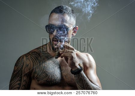 Sexy Man With Bare Torso. Brutal Handsome Man With Tattooed Body. Men Tattoo Casual Fashion. Portrai