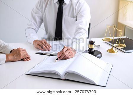 Businesspeople Or Lawyer Having Team Meeting Discussing Agreement Contract Documents, Judge Gavel Wi
