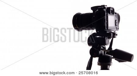 Black digital camera isolated on white