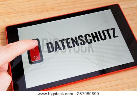 Tablet With Button In German Datenschutz In English Privacy On