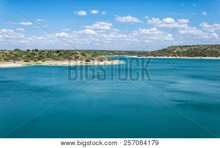 Blue Landscape With A Lake And Cloudy Sky