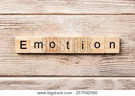 Emotion Word Written On Wood Block. Emotion Text On Table, Concept.