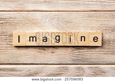 Imagine Word Written On Wood Block. Imagine Text On Table, Concept.