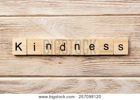 Kindness Word Written On Wood Block. Kindness Text On Table, Concept.