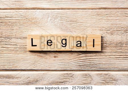 Legal Word Written On Wood Block. Legal Text On Table, Concept.