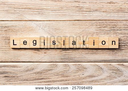 Legislation Word Written On Wood Block. Legislation Text On Table, Concept.