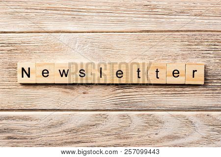 Newsletter Word Written On Wood Block. Newsletter Text On Table, Concept.