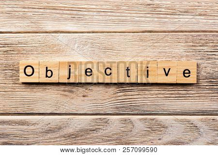 Objective Word Written On Wood Block. Objective Text On Table, Concept.