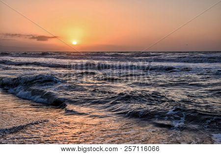 Golden Hour On The Beach. Sunrise On The Sea In Torremolinos, Málaga. Spain.